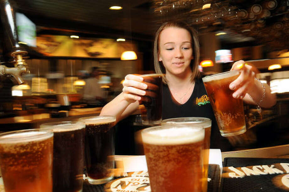 Bartender Ali Owens fills orders for the house beers at Two Rows brewpub earlier this year. Photo: Dave Rossman:, For The Chronicle