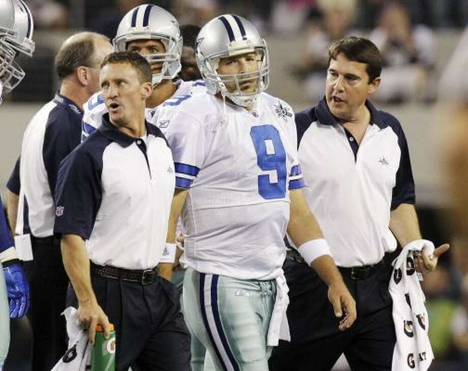 Cowboys quarterback Tony Romo leaves the field during the second quarter against the Giants on Monday night. Photo: LM Otero, AP