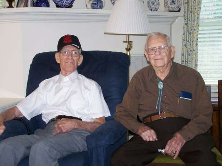 Former POWs Buddy Fouga, left, and Bart Robertson served part of their tour of duty during World War II behind enemy lines. Veterans Day is a meaningful day for them. Photo by Wallace Klekar: VFW Post 9182. Photo: ALL