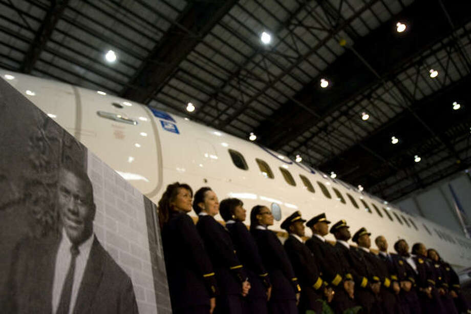 Continental Airlines pilots and flight attendants gather Tuesday in front of a Boeing 737 named after the late Marlon Green, the nation's first African-American commercial pilot, in a hangar at Bush Intercontinental Airport. Photo: Johnny Hanson, Chronicle
