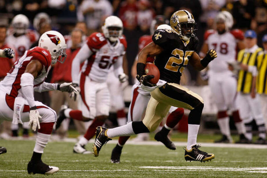 Reggie Bush put on a show in the victory over the Cardinals, scoring on a 46-yard run and an 83-yard punt return. Photo: Chris Graythen, Getty Images