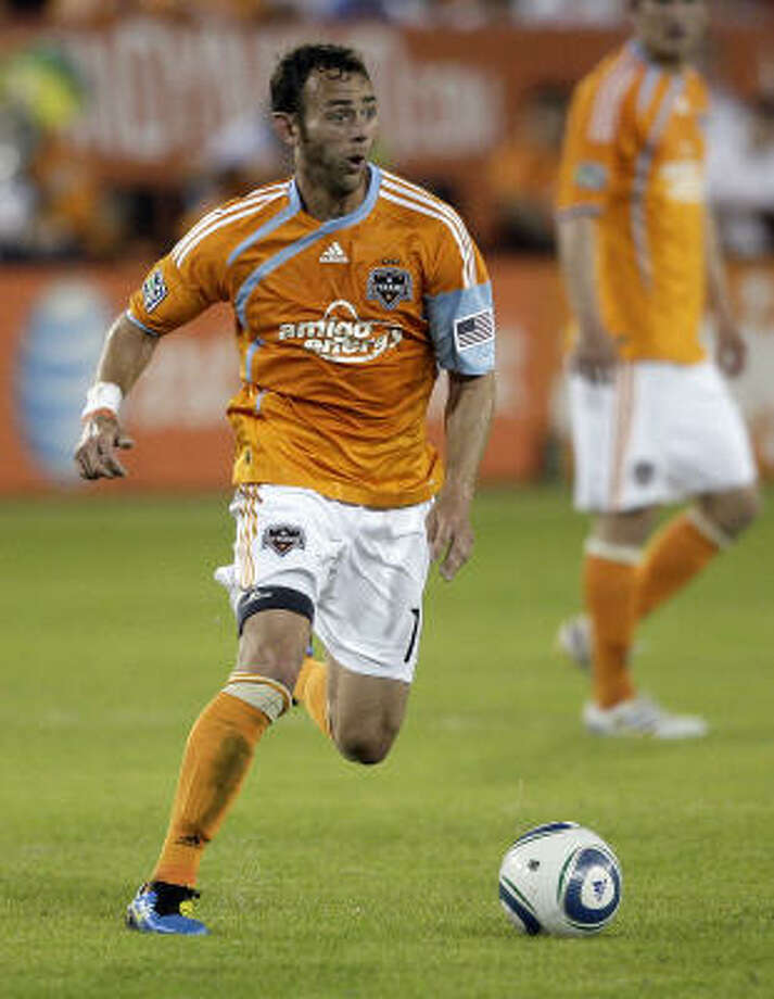 Brad Davis looks for someone to pass to as he brings the ball up the field against Real Salt Lake on April 1. Photo: Bob Levey, Getty Images