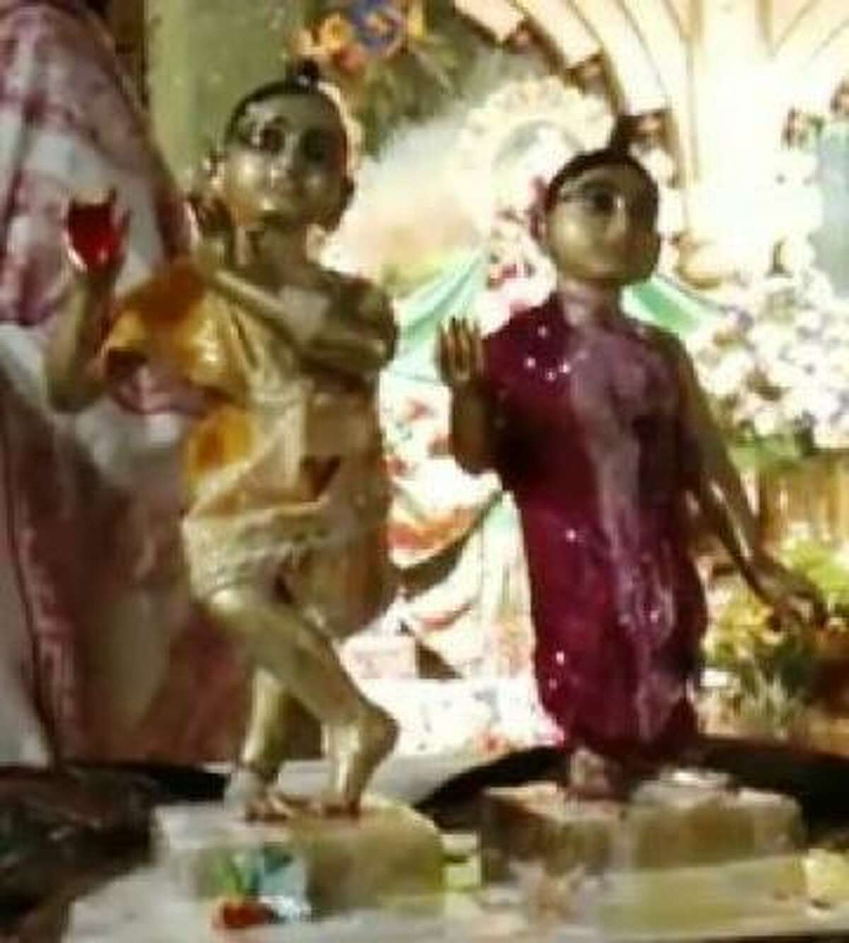 The two statues known as Sri Sri Radha Giridhari are revered as personalities by worshippers at the Houston temple.