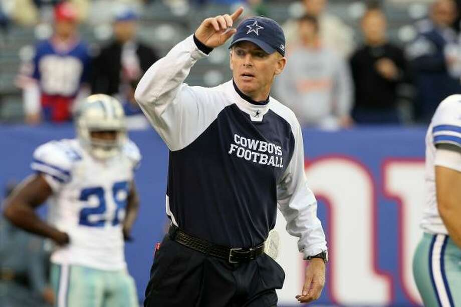 Jason Garrett's belief in the need for physical practices reflects Jimmy Johnson's influence. Photo: Jim McIsaac, Getty Images