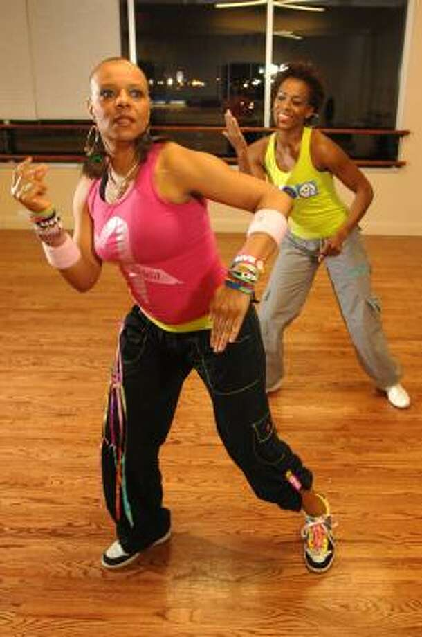 HIGH ENERGY: Karen Franklin, Zumba Dance Instructor, dances with one of her students, Kim Ross, during one of her recent classes held at the Barbara King Dance Company in Bellaire. JERRY POWERS: FOR THE CHRONICLE Photo: Jerry Powers, For The Chronicle