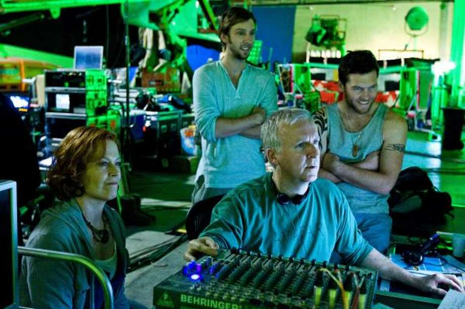 Writer-director James Cameron, foreground, reviews a scene with actors, from left, Sigourney Weaver, Joel David Moore and Sam Worthington during the filming of Avatar. Photo: MARK FELLMAN :, TWENTIETH CENTURY FOX