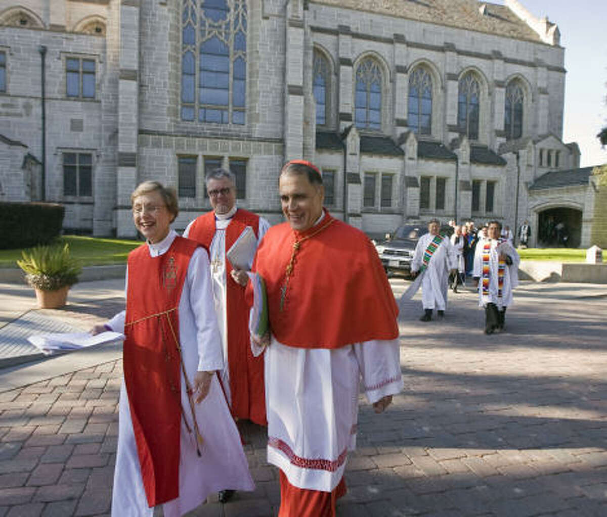 Cardinal Daniel DiNardo, right, United Methodist Bishop Janice Riggle Huie, Episcopal Bishop C. Andrew Doyle and 300 other clergy leaders met at Saint Paul's Methodist Church on Monday to push for immigration reform.