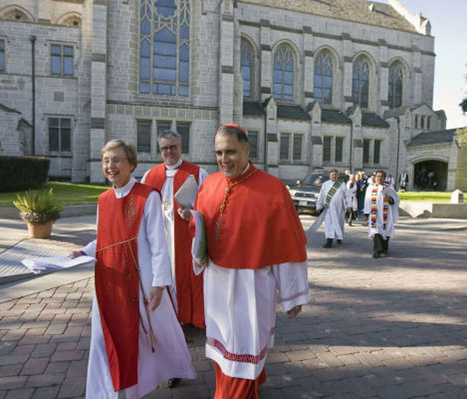 Cardinal Daniel DiNardo, right, United Methodist Bishop Janice Riggle Huie, Episcopal Bishop C. Andrew Doyle and 300 other clergy leaders met at Saint Paul's Methodist Church on Monday to push for immigration reform. Photo: James Nielsen, Chronicle