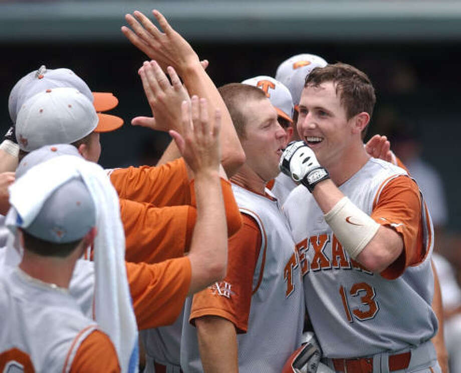After a career at the University of Texas that included a national championship, Drew Stubbs, right, was drafted eighth overall in 2006 by the Cincinnati Reds. Photo: SUSAN ALLEN SIGMON, AP
