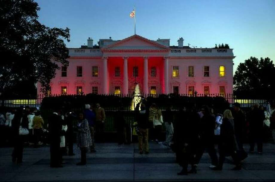 The White House is bathed in pink light for National Breast Cancer Awareness Month on Thursday night. Photo: Jim Watson, AFP/Getty Images