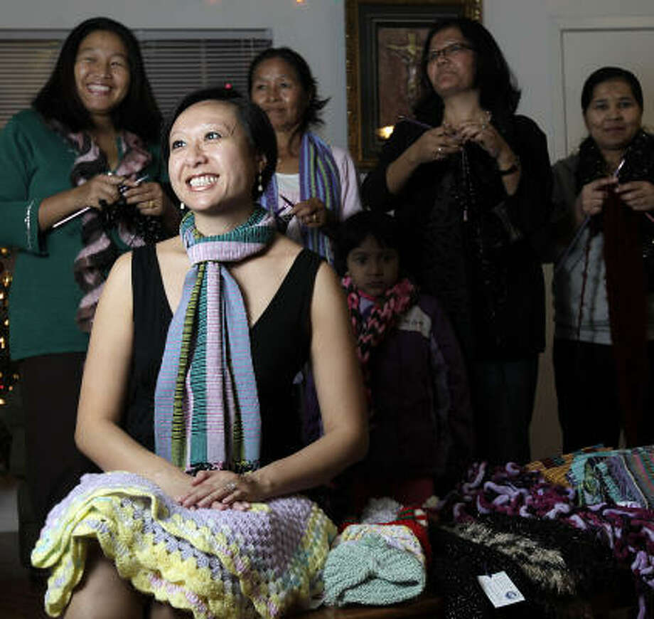 Quynh-Anh McMahan, front, and The Community Cloth support artisans, including Devi Subba, from left, Mon Rai, Nar Rai and Nirmala Neopaney, with daughter Anju, 6. Photo: Karen Warren, Chronicle