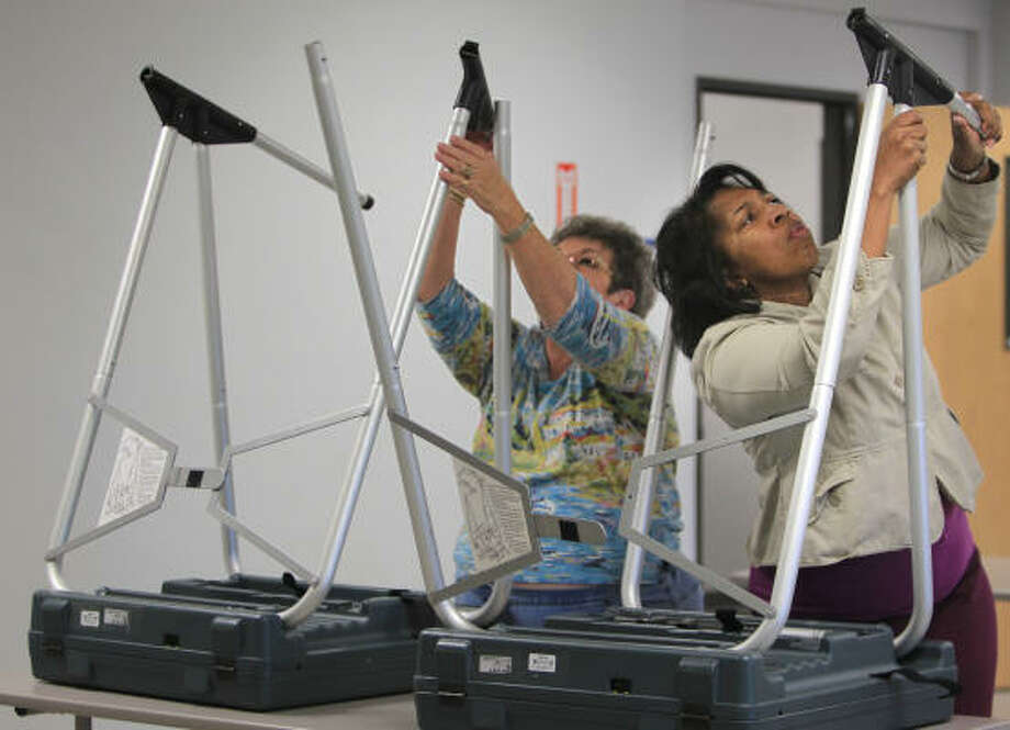 Carol Stone, left, and Betty Vanghn were busy Friday getting voting machines set up at the Trini Mendenhall Sosa Community Center in Houston for today's start of early voting. Photo: Mayra Beltran, Chronicle