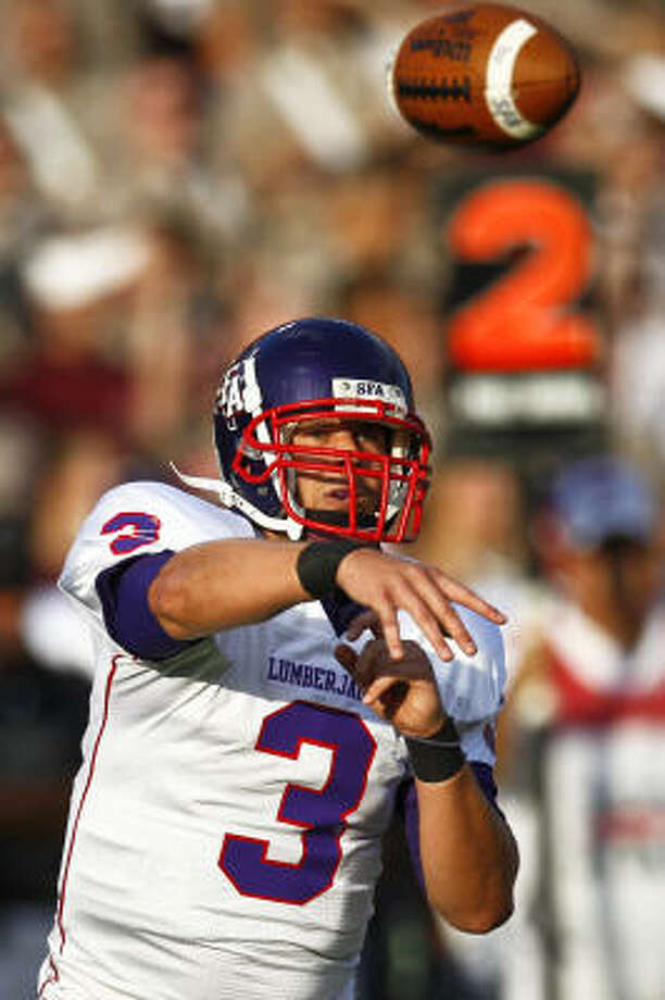 SFA quarterback Jeremy Moses has thrown for 1,865 yards and 16 touchdowns through six games. Photo: Michael Paulsen, Chronicle