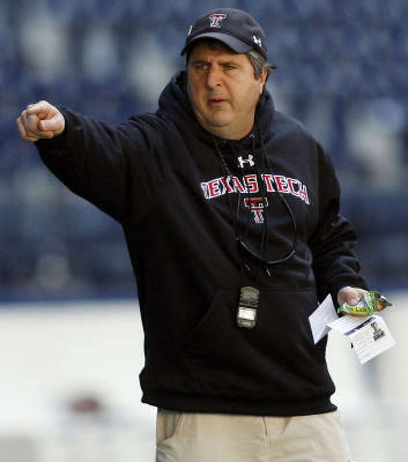 Mike Leach was fired Wednesday amid allegations of mistreating injured receiver Adam James. Photo: MIKE STONE, AP