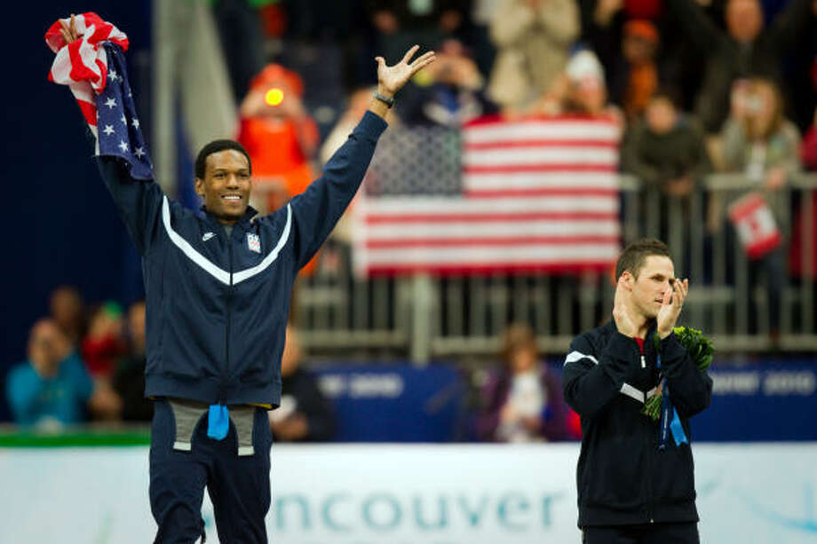 Shani Davis, left, and Chad Hedrick of the United States celebrate on the podium after the men's speed skating 1000m final. Davis won the gold medal. Hedrick won the bronze. Photo: Smiley N. Pool, Chronicle Olympic Bureau