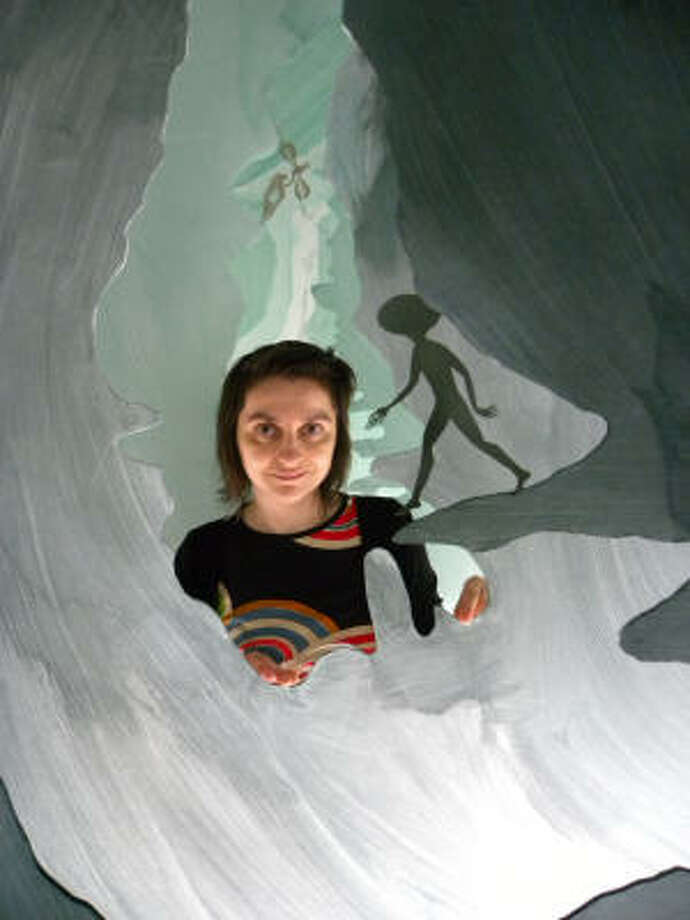 Artist Andrea Dezsö works on her installation Sometimes in My Dreams I Fly at Rice University Art Gallery. Photo: Douglas Britt, Houston Chronicle
