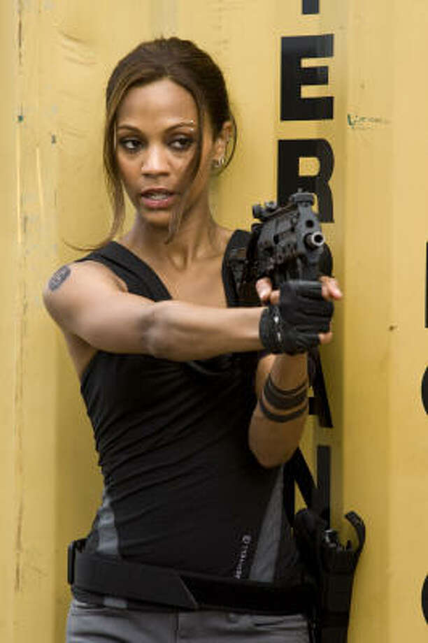 Zoe Saldana plays a mystery woman who helps a group of CIA agents get back at a rogue agent who tried to kill them. Photo: John Bramley