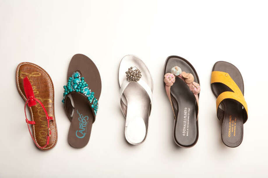 From left, Sam Edelman coral Gigi flat sandal, $49.95, Nordstrom; Carlos Santana teal Tahiti embellished flip flop, $49.99 sale, Macy's; Calvin Klein white flip flop, $69, Macy's; Donald J. Pliner Calido platform, $150 sale, donaldjpliner.com; and Donald J Pliner yellow cross-sandle, $155, donaldjpliner.com. Photo: Nick De La Torre, Chronicle