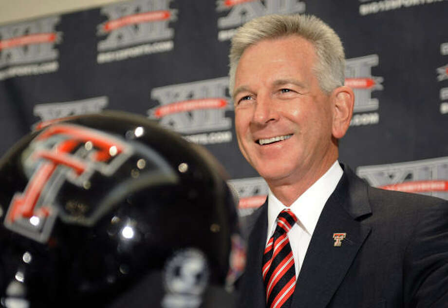 Texas Tech coach Tommy Tuberville answers questions at Big 12 media day. Photo: Cody Duty, AP