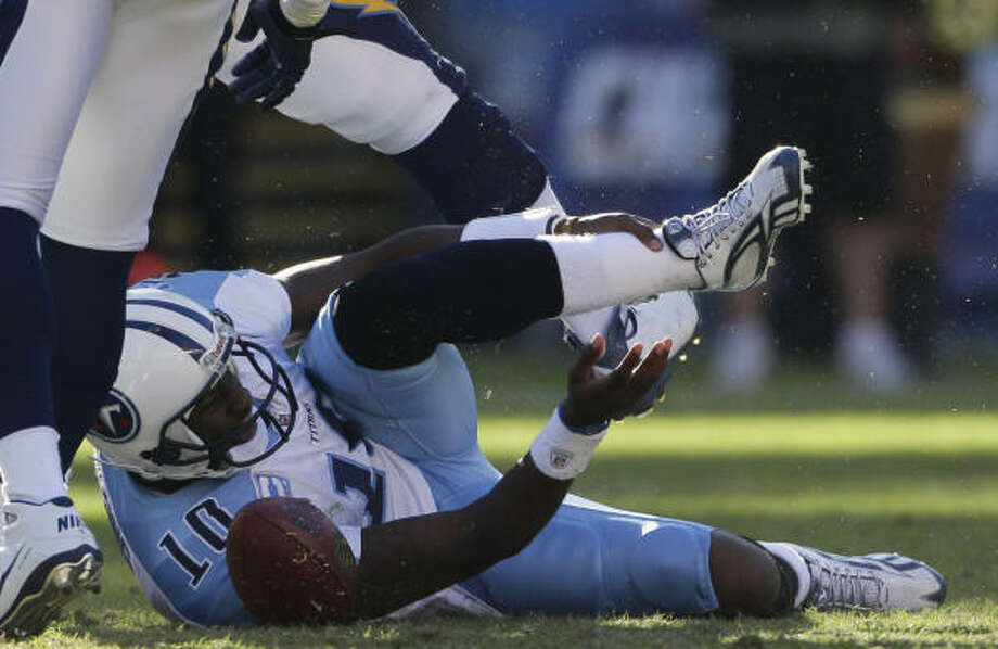 Titans quarterback Vince Young holds his leg after being injured on a play in the second half. Photo: Gregory Bull, AP