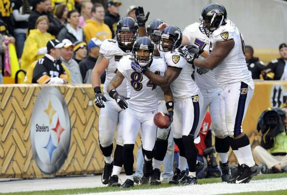 The Steelers and Ravens, tied for first in the AFC North with 8-3 records, play tonight. The Ravens won the first game 17-14. Photo: Don Wright, AP