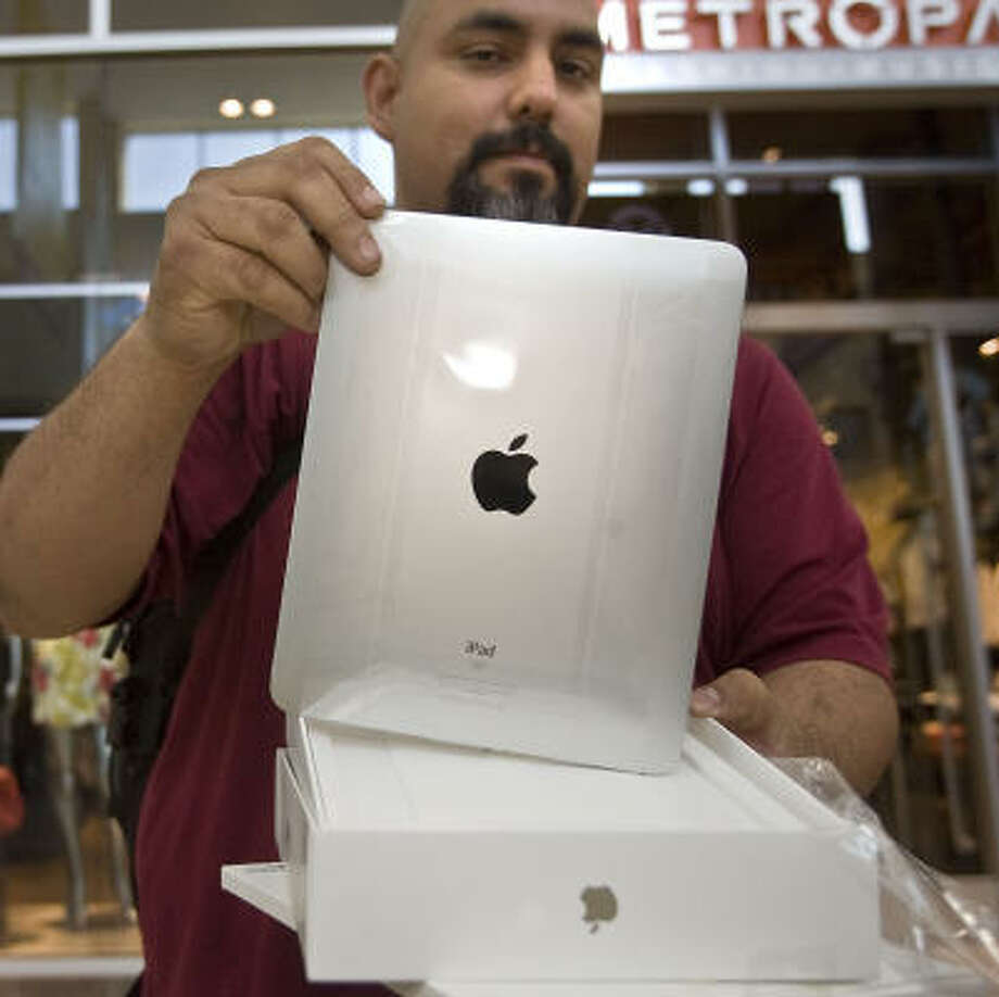 Orlando Castro was first in line for the new iPad at Memorial City Mall. Photo: James Nielsen, Chronicle