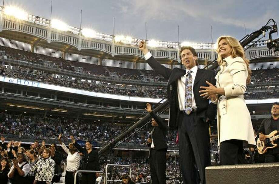 Joel and Victoria Osteen led an event in 2009 at Yankee Stadium in New York. They will preach to more than 50,000 people at a sold-out event Saturday at Dodger Stadium in Los Angeles. Photo: Joel Osteen Ministries