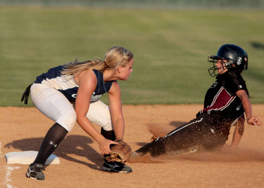 Pearland's Megan Coronado slides into third ahead of the tag by Clements third baseman Nicole Defee. Photo: Thomas B. Shea, For The Chronicle