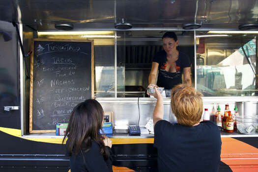 """Fusion TacoJulia Sharaby helped usher in a new wave of food truck in Houston  when her Fusion Taco got rolling in May 2010. But she didn't think of  herself a pioneer as much as a potential game changer. """"I consider myself the one who thought I could come in and change all  the city ordinances. I thought I'd be the one,"""" she said. """"But that  wasn't true.""""One thing you might not know about Sharaby:""""Aji Amarillo peppers are something I'd love to find a way to put in a taco but haven't done yet."""" Photo: Michael Paulsen:, Chronicle"""