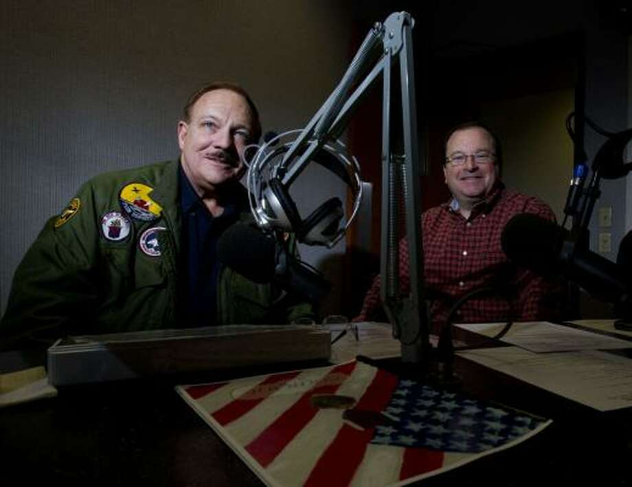 Jim Mehrmann, left, and Dave Maulsby, radio hosts on the Our Military Heroes  show on KNTH 1070 AM and KKHT 100.7 FM get ready for their show. The men began the military-focused one-hour talk show in February. Photo: Johnny Hanson, Houston Chronicle