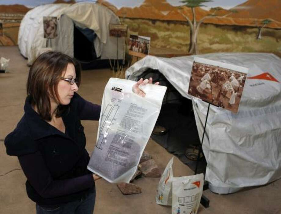 Amanda Pennington reads a bag of beans at World Vision's warehouse in Denver. The Christian humanitarian agency is shipping 20 tons of tents, blankets, cooking utensils and other equipment to Haiti. Photo: ED ANDRIESKI :, ASSOCIATED PRESS