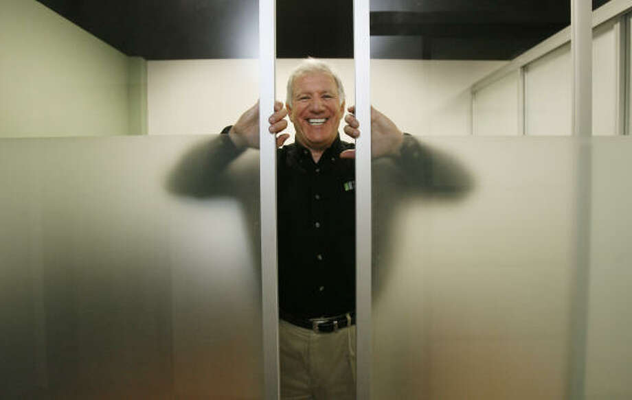 Ron Jacobs, president of The Sliding Glass Door Company of Texas, offers a hands-on demonstration in his Houston showroom. Photo: Billy Smith II :, Chronicle
