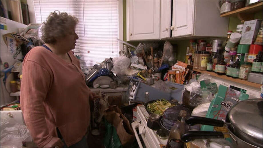 "The TV program ""Hoarders"" examines why some people aren't able to throw away things that are cluttering their homes. Photo: A&E 