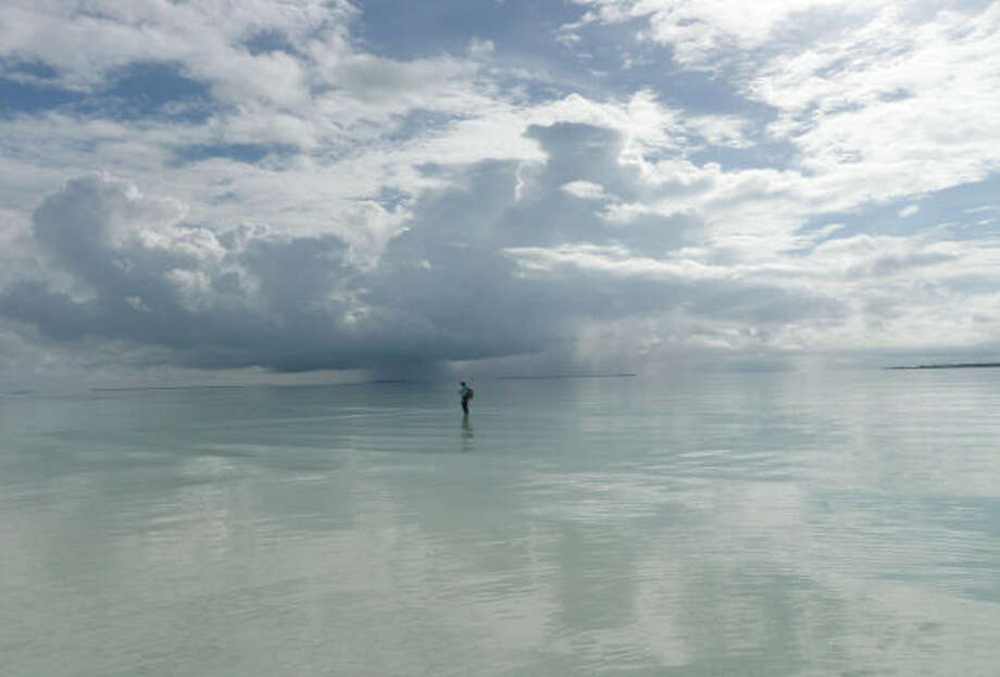 Remote Christmas Island, located south of Hawaii, offers some of the finest hard-sand flats in the world for sight casting to bonefish. Photo: Joe Doggett, For The Chronicle