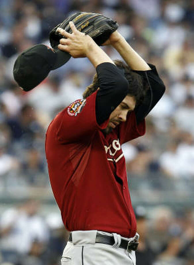 Astros reliever Casey Daigle reacts on the mound after giving up a fifth-inning grand slam to Jorge Posada, the first batter he faced. Photo: Kathy Willens, AP