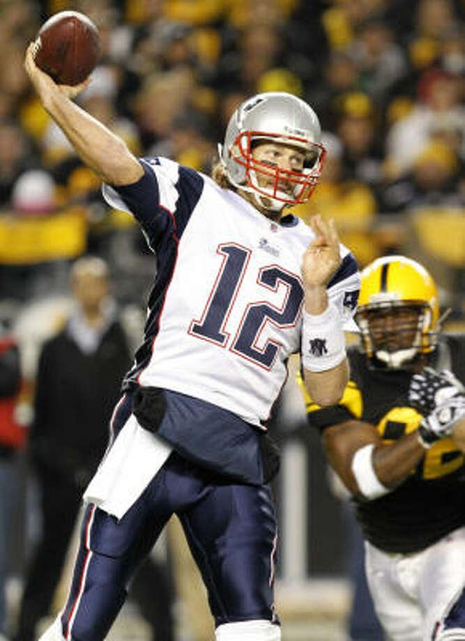Patriots quarterback Tom Brady was 30 of 43 for 350 yards with no sacks or interceptions on Sunday night. Photo: Gene J. Puskar, AP