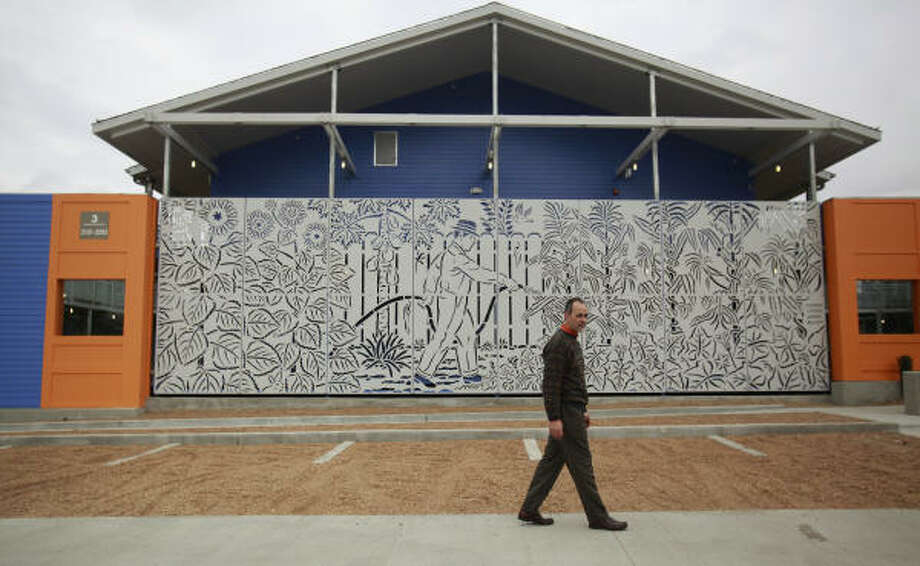 Architect Ernesto Maldonado walks in front of the steel papel picado at Brays Crossing, where Elma lives in the East End. Photo: Mayra Beltran, Chronicle