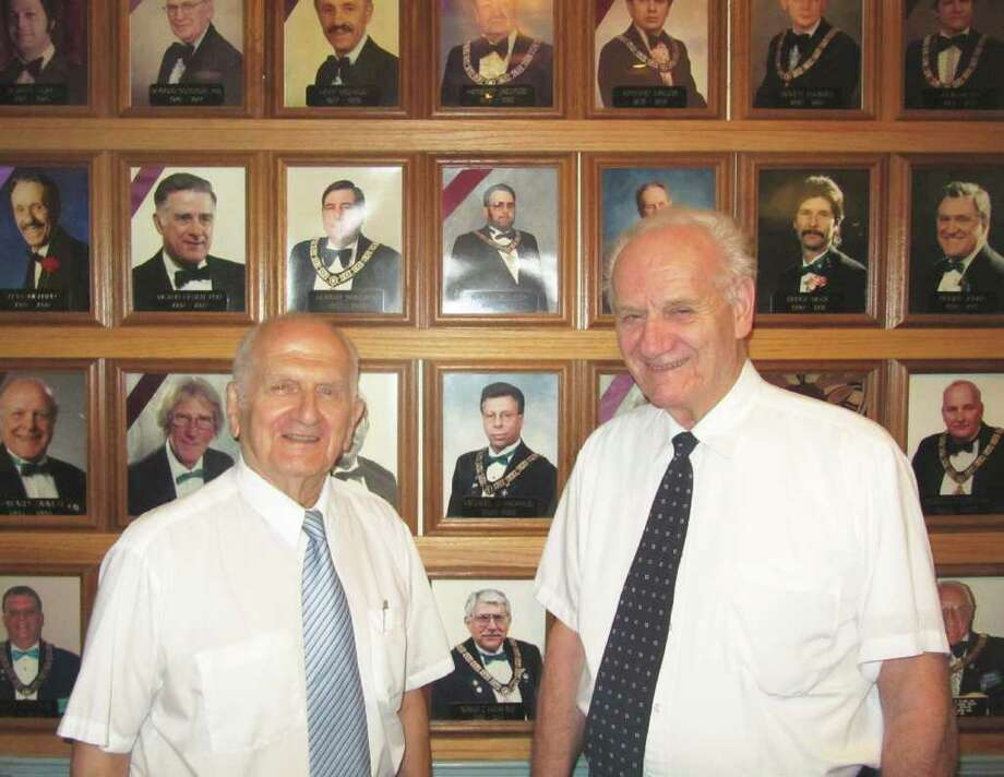 Fairfield Elks Lodge #2220, located at 452 Brookside Drive, is celebrating its 50th anniversary this year. Standing in front of past exalted rulers, otherwise known as presidents, are founding Elks members Bill George and Frank Chizmadia. Photo: Kirk Lang / Fairfield Citizen