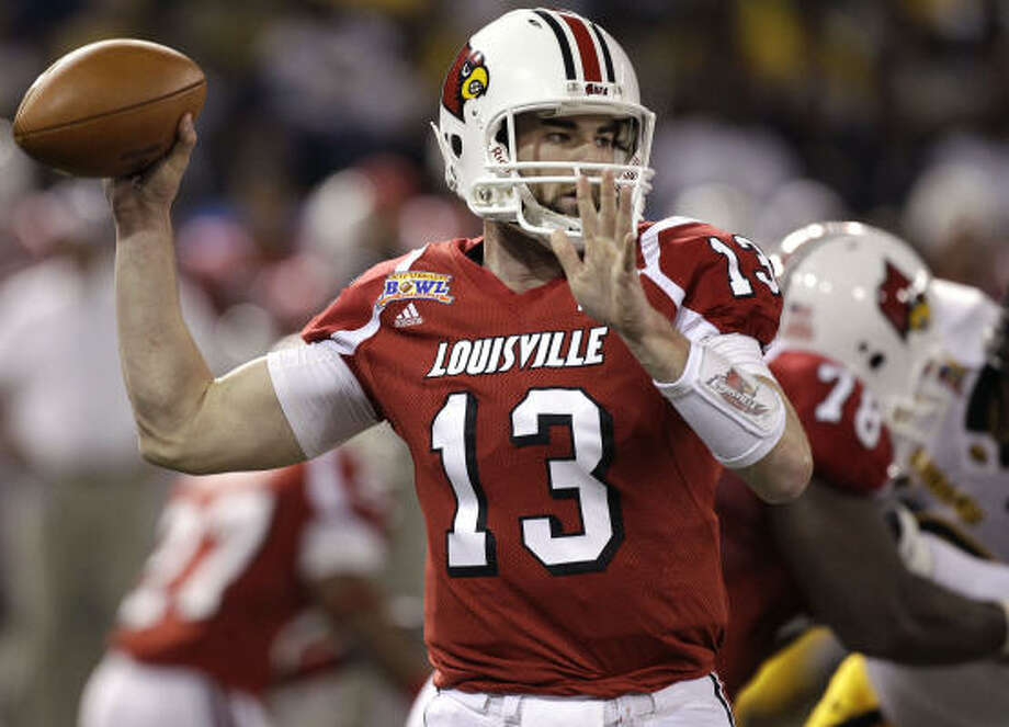 Louisville quarterback Justin Burke completed 20 of 32 passes, including a pair of touchdown tosses in the victory. Photo: Chris O'Meara, AP