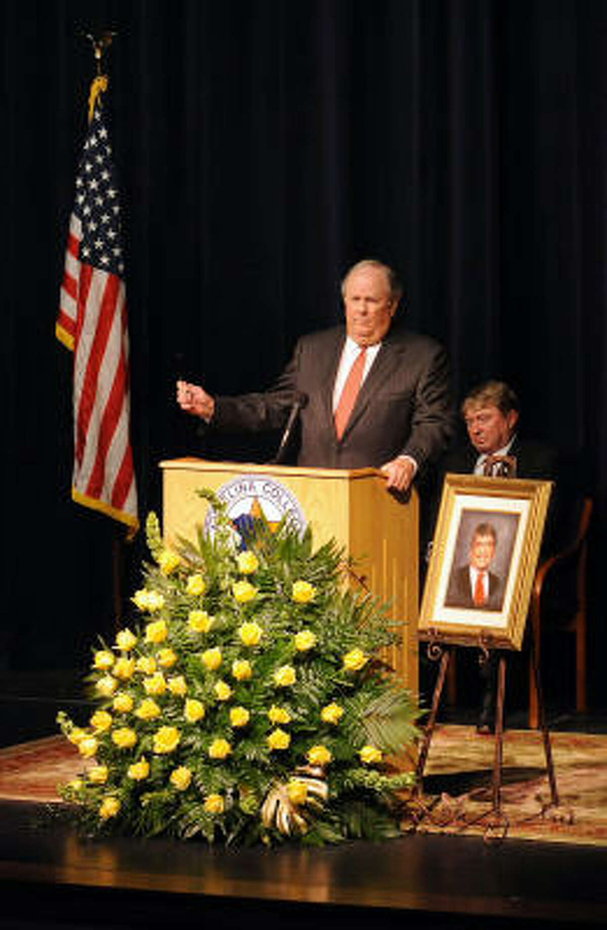 Longtime family friend Buddy Temple speaks at former U.S. Rep. Charlie Wilson's memorial service at Angelina College in Lufkin on Sunday.