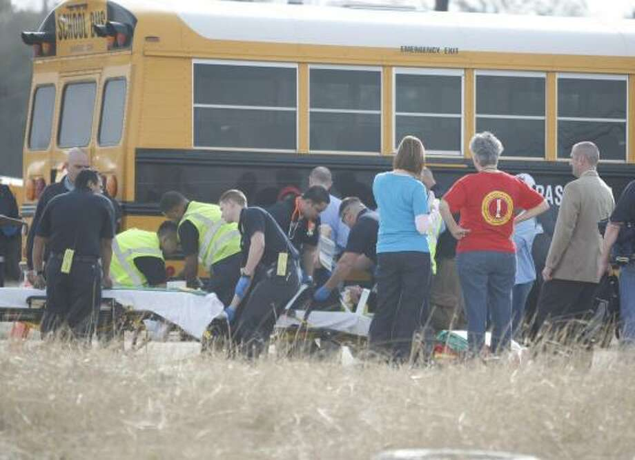 At least 13 Bondy Intermediate students in Pasadena were taken to local hospitals for precautionary reasons today after a school bus collided with a pickup this morning. There were not thought to be any serious injuries. Photo: Nick De La Torre, Chronicle