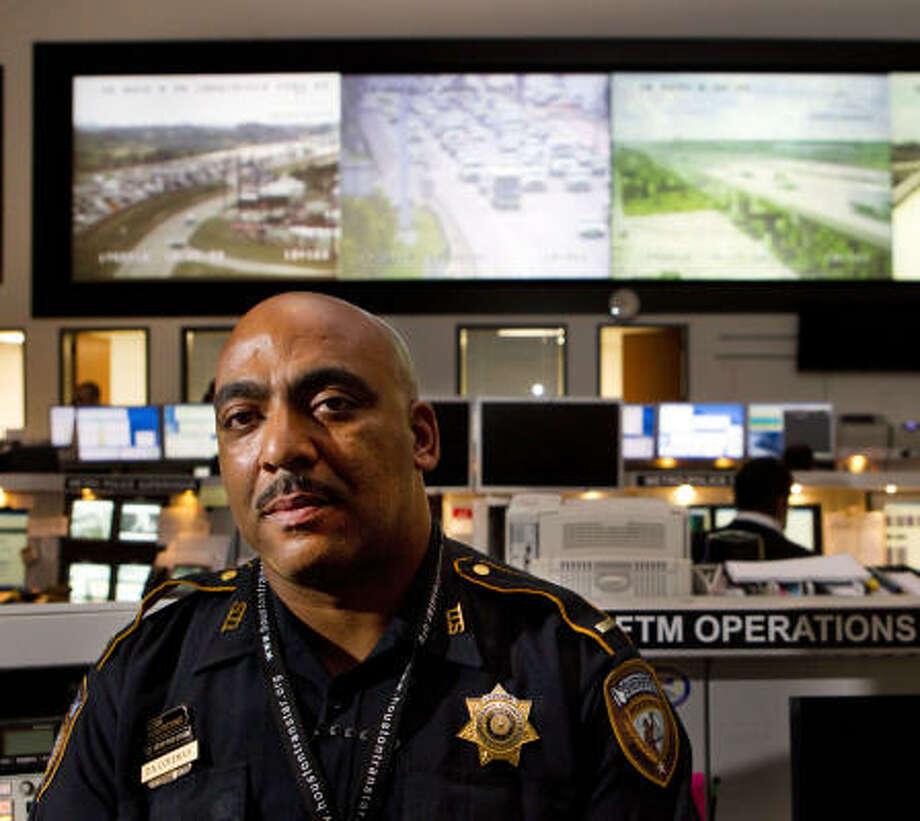 Harris County Sheriff's Deputy Lt. Darryl Coleman has a clear view of Houston-area traffic from his post inside TranStar's nerve center, which has more than 700 cameras in use. Photo: Brett Coomer, Chronicle