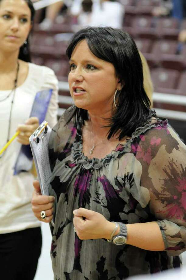 Cy-Fair volleyball coach Donna Benotti fires up her Lady Bobcats at the Class 5A Region 3 Tournament on 11-12-10 at the Campbell Center. Photo: L. Scott Hainline / freelance