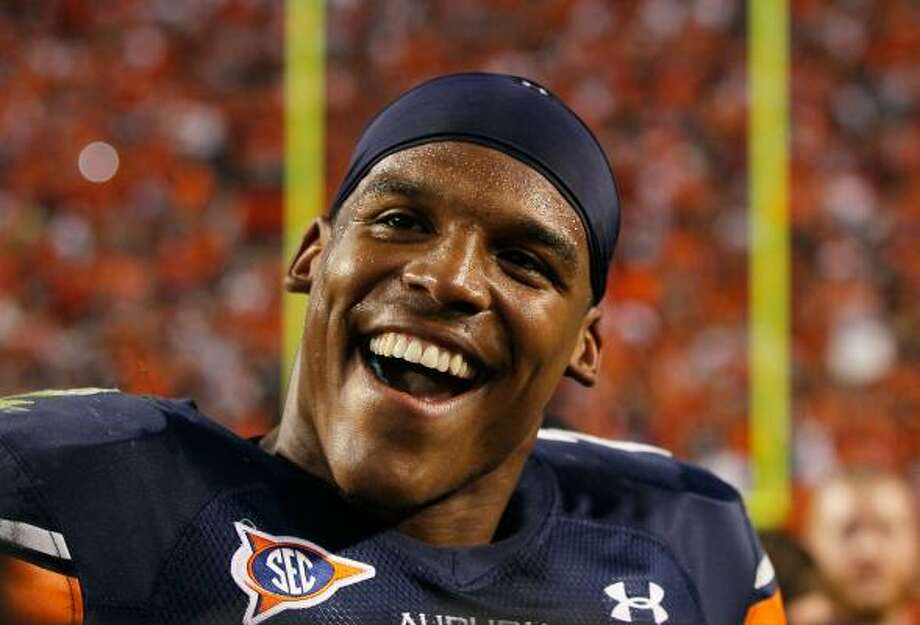 Cameron Newton and the Auburn Tigers have plenty to smile about. Photo: Kevin C. Cox, Getty Images