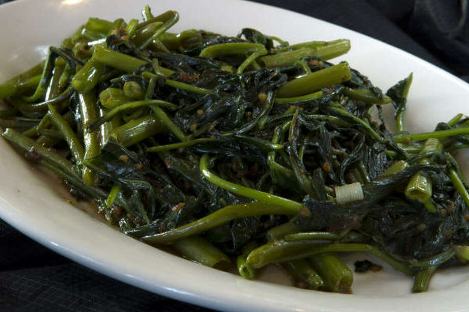 Cah Kangkung: stir-fried water spinach with garlic Photo: Brett Coomer :, Houston Chronicle