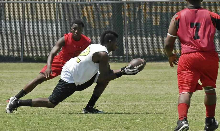Willie Gillum (#2) with Jones catches the ball on his fingertips during their game with Furr at the HISD summer 7-on-7 league games at Butler Stadium Saturday 5/28/11. Photo by Tony Bullard. Photo: Tony Bullard / Credit: for the Chronicle