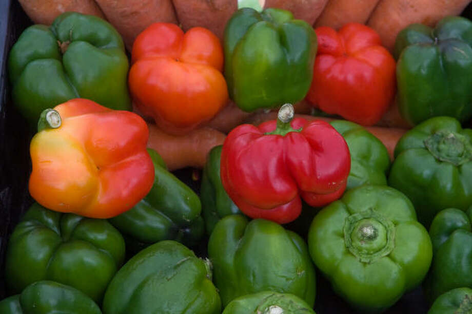 "FRESH-GROWN BOUNTY: These bell peppers, from ""Village Botanica"" in Waller, were found  at the Urban Pickins Farmers Market. Photo: R. Clayton McKee, For The Chronicle"