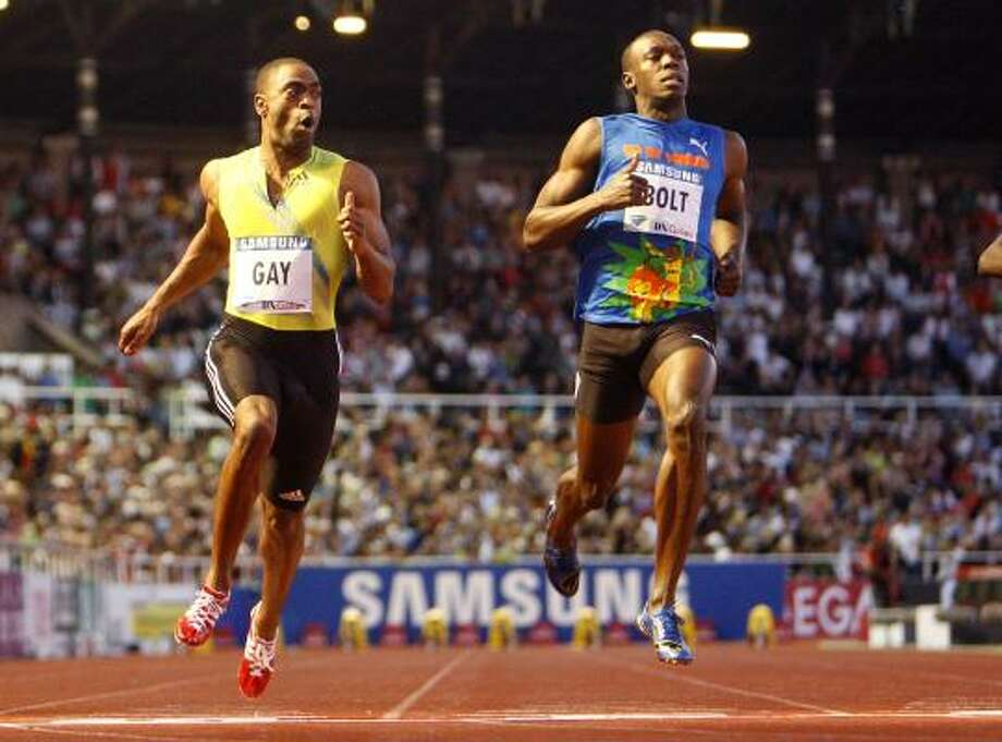 American sprinter Tyson Gay, left, beats Jamaican Usain Bolt in the 100 meters on Friday in Stockholm. Photo: Michael Probst, AP
