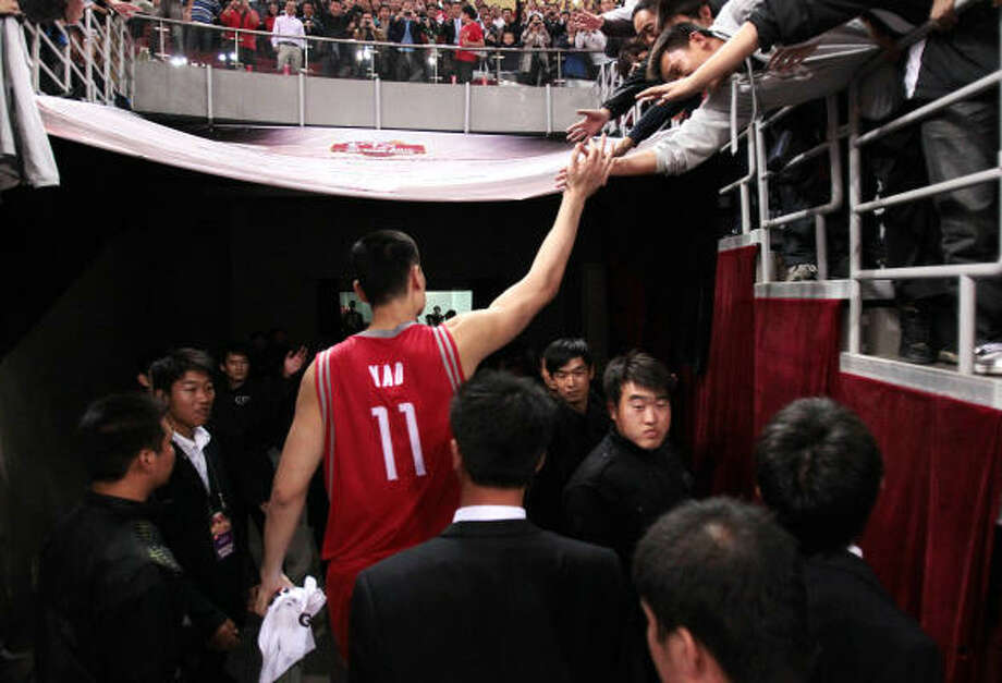 Rockets center Yao Ming left the fans feeling happy with his return and solid performance. Photo: Billy Smith II, Chronicle