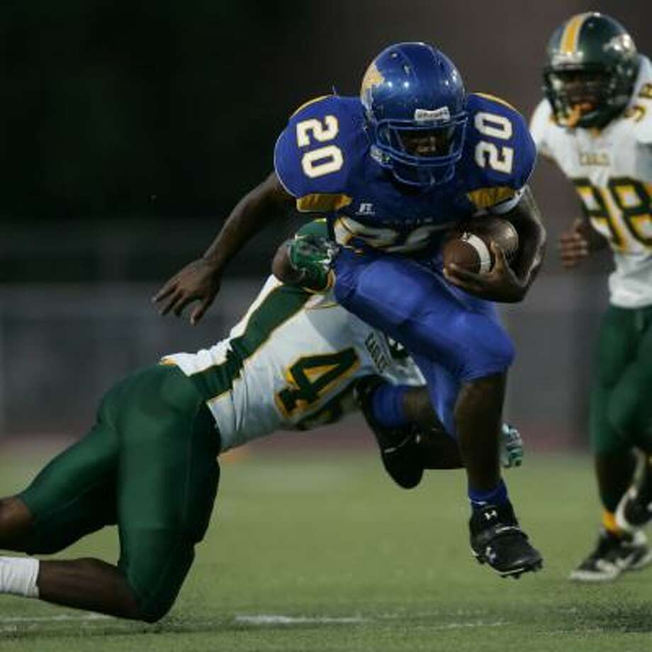Klein's Keshawn Hill (20) runs past Klein Forest's Kasey Simmons for a 25-yard, first-quarter touchdown Friday night. Photo: ERIC CHRISTIAN SMITH, For The Chronicle